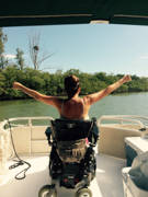 Young-woman-using-power-wheelchair-on-boat