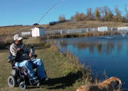 Man-in-power-wheelchair-fishing-in-lake