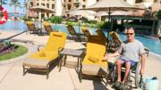 Man-using-wheelchair-at-resort-pool