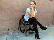 Outdoor-portrait-of-young-woman-using-wheelchair