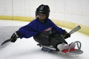 Young-boy-playing-sled-hockey