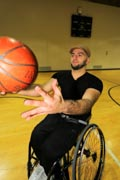 Young-man-playing-wheelchair-basketball