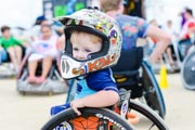 Young-boy-in-wheelchair-at-sports-clinic